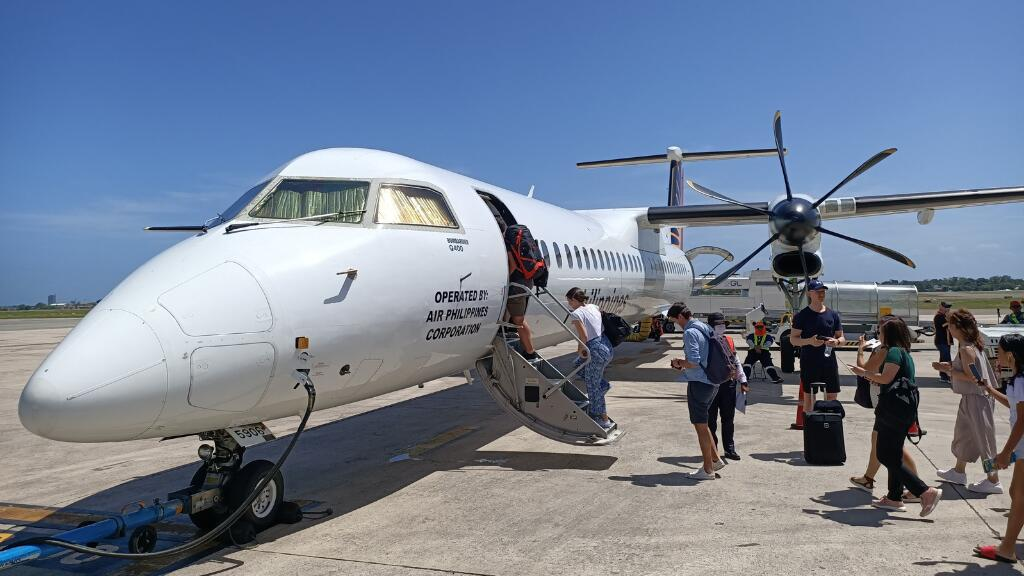 passengers boarding flight to Siargao