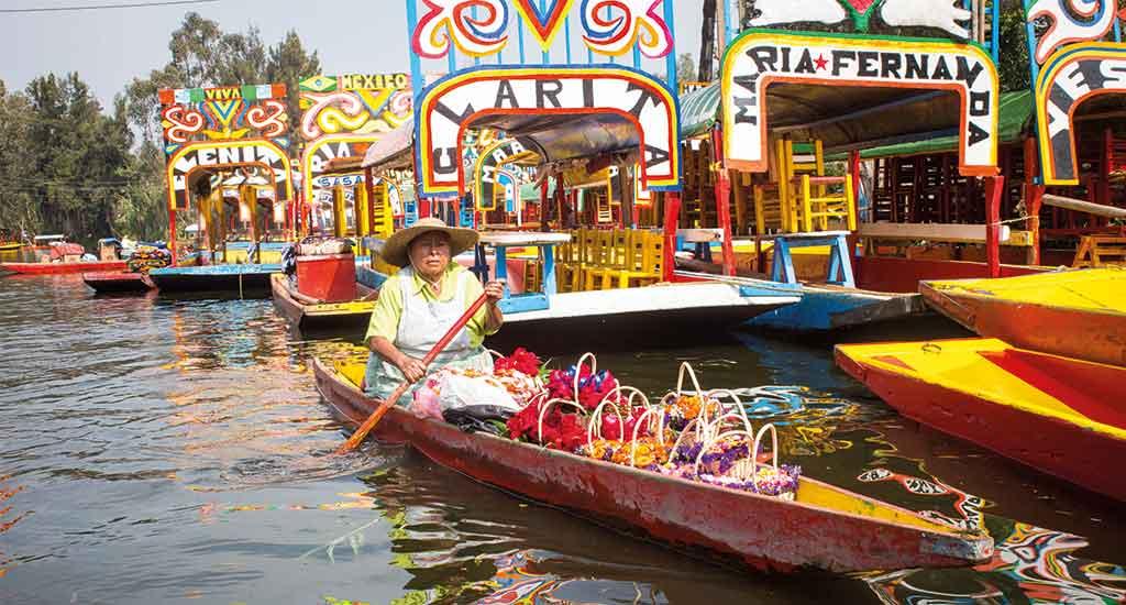 Trajinera boats in Xoxhimilco canal Mexico