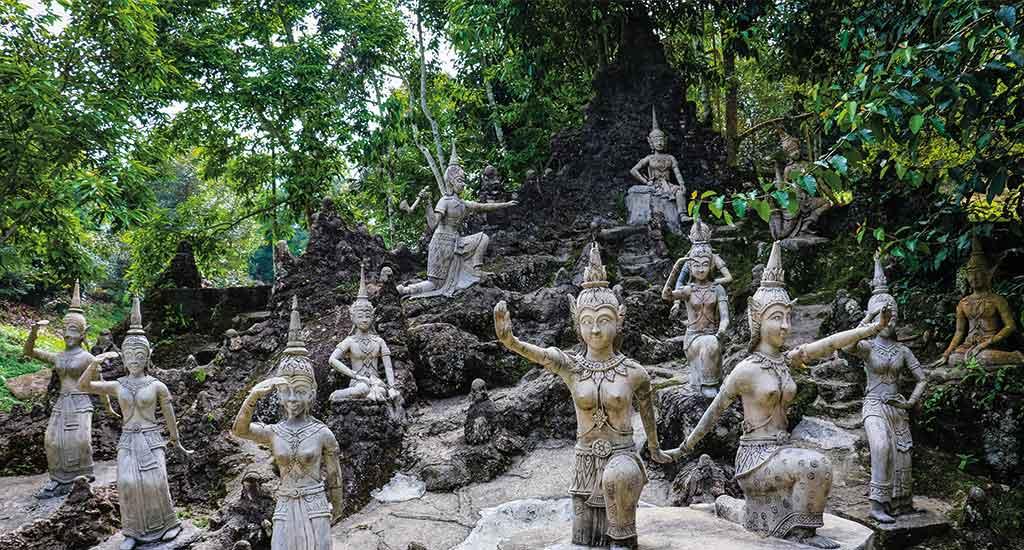 Ancient stone statues in secret Buddhism magic garden in Koh Samui
